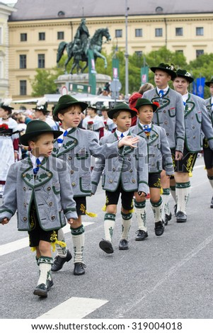 MUNICH, GERMANY - SEPTEMBER 20, 2015: The Oktoberfest is the world biggest beer festival and at the opening parade with rd. 9000 participants take part in historical costumes, music bands and horses. - stock photo