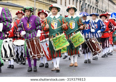 MUNICH, GERMANY - SEPTEMBER 20, 2015: The Oktoberfest is the world biggest beer festival and at the opening parade with rd. 9000 participants take part with historical costumes, music bands and horses