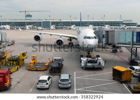 MUNICH, GERMANY, SEPTEMBRE 2014: Lufthansa airbus airplane parked on Munich airport while people are boarding to the flight  SEPTEMBRE 2014 in MUNICH, GERMANY - stock photo