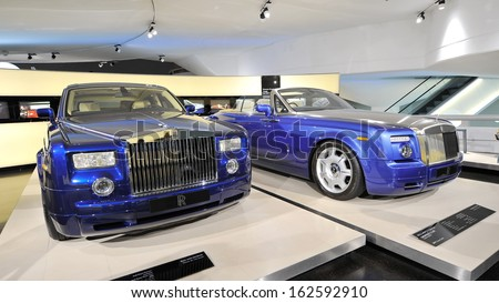 MUNICH - JUNE 8: Rolls Royce Phantom and Drophead Coupe on display in BMW Museum on June 8, 2013 in Munich - stock photo