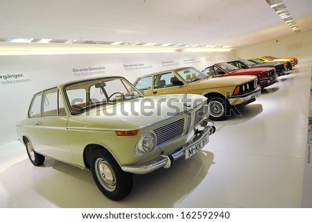 MUNICH - JUNE 8: Row of classic to modern BMW 3 series on display in BMW Museum on June 8, 2013 in Munich - stock photo