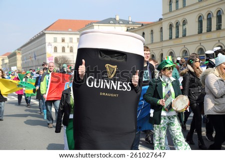 MUNICH - MARCH 15: irish beer advertising is marching at St. Patrick's day on March 15, 2015 in Munich, Germany. This national Irish holiday takes place annually  in Dublin and other European cities.