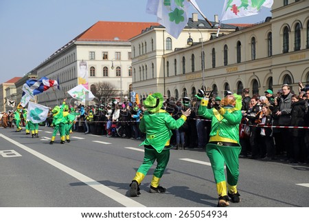 MUNICH - MARCH 15: irish juggler march at St. Patrick's day on March 15, 2015 in Munich, Germany. This national Irish holiday takes place annually in March in Dublin and other European cities. - stock photo