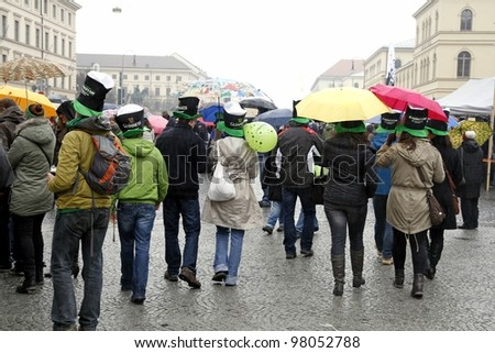 MUNICH - MARCH 11:people in irish hats celebrates St. Patrick's day on March 11, 2012 in Munich, Germany. This national Irish holiday takes place annually in March in Dublin and other European cities. - stock photo