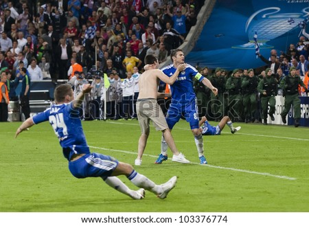 MUNICH-MAY 19 :Celebration of Chelsea's win: Lampard with a supporter after FC Bayern Munich vs. Chelsea FC UEFA Champions League Final game at Allianz Arena on May 19, 2012 in Munich, Germany. - stock photo