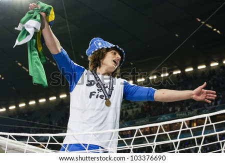 MUNICH-MAY 19 : David Luiz of Chelsea sits on the post after FC Bayern Munich vs. Chelsea FC UEFA Champions League Final game at Allianz Arena on May 19, 2012 in Munich, Germany. - stock photo