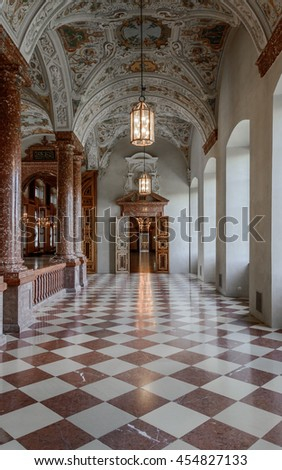 MUNICH (MUNCHEN), GERMANY - 03 MAY 2016: Perspective view to the gold luxury interior of Imperial Staircase with door portal and Imperial Hall (Kaisertreppe, Kaisersaal) in Munich Residence Museum.