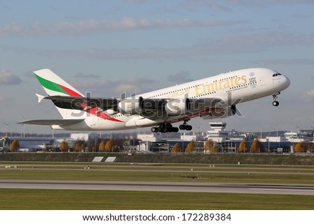MUNICH - OCTOBER 24: An Emirates Airbus A380 Superjumbo taking off on October 24, 2013 in Munich. The Airbus A380 is the world's largest passenger airliner. Emirates is an airline based in Dubai. - stock photo