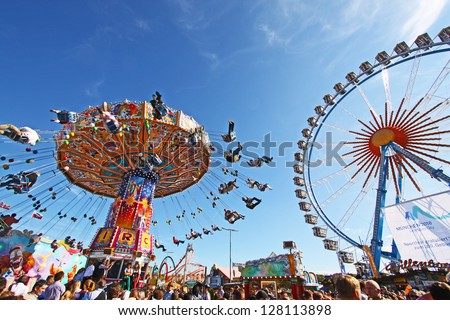 MUNICH - OCTOBER 3: The chairoplane is spinning at the Oktoberfest fair ground in Munich on October 3, 2010 in Munich, Germany. - stock photo