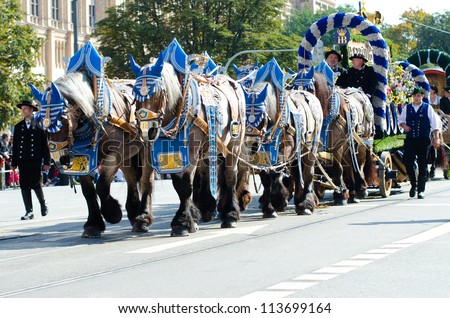 MUNICH - SEPTEMBER 23: Adorned thoroughbred horses at the costume and Riflemen's Parade during the Oktoberfest in Munich, Germany on September 23, 2012. - stock photo