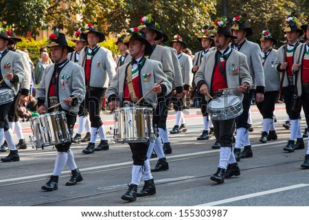 MUNICH - SEPTEMBER 22: Music brigade at the traditional costume and Riflemen's Parade during the Oktoberfest in Munich, Germany on September 22, 2013.