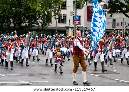 MUNICH - SEPTEMBER 22: musicians dressed in national costumes take part into Oktoberfest solemn procession September 22, 2012 in Munich, Bavaria, Germany. Oktoberfest is annually  beer festival.