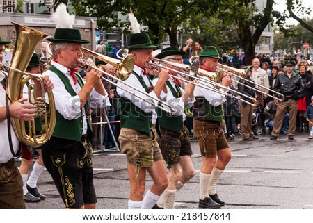 MUNICH - SEPTEMBER 20: musicians dressed in national costumes take part into Oktoberfest solemn procession September 20, 2014 in Munich, Bavaria, Germany. Oktoberfest is annually beer festival. - stock photo