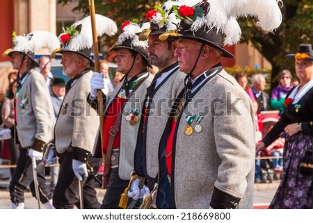 MUNICH - SEPTEMBER 21: Opening of Oktoberfest September 21, 2014 in Munich, Germany. Horse carriages and bands takes part into Oktoberfest solemn procession.