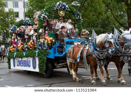 MUNICH - SEPTEMBER 22: Opening of Oktoberfest September 22, 2012 in Munich, Germany. Horse carriage takes part into Oktoberfest solemn procession.