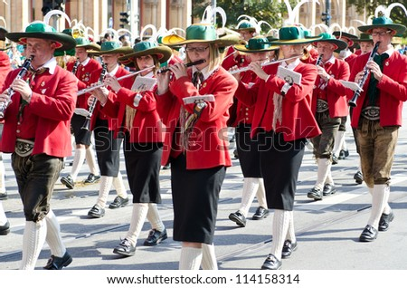 MUNICH - SEPTEMBER 23: Participants with a traditional bavarian costume at the costume and Riflemen's Parade during the Oktoberfest in Munich, Germany on September 23, 2012. - stock photo