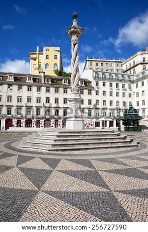 Municipal Square (Portuguese: Praca do Municipio) with 18th century pillar called pelourinho (pillory) in Lisbon, Portugal.  - stock photo