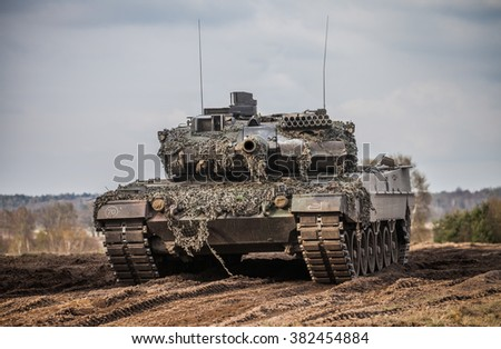 """MUNSTER / LOWER SAXONY / GERMANY - APRIL 2013: german main battle tank """"leopard 2 a 6 """" stands on the german military training ground in munster / germany at april 2013 - stock photo"""