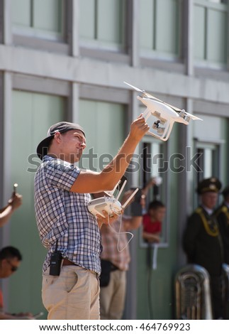 MUR0M, RUSSIAN FEDERATION - AUGUST 6, 2016: Cameraman works with quadrocopter during the International Army Games-2016