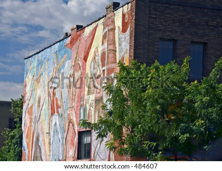 Mural of Craftspersons Against the Blue Sky - stock photo