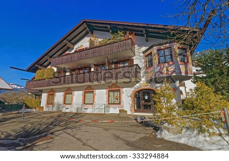 Murals on the outside walls of the charming house in Garmisch-Partenkirchen. It a mountain resort town in Bavaria, southern Germany, in the heart of the Alps. - stock photo