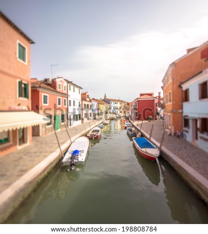 Murano and Burano island, street with glass store, beautiful colorfull  houses, boats - stock photo