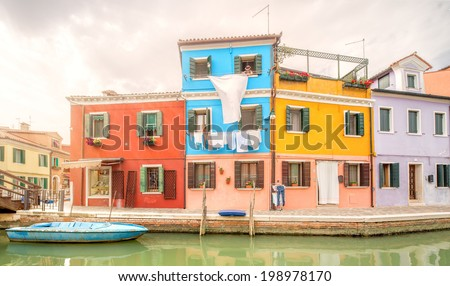 Murano and Burano island, street with glass store, beautiful colorfull  houses, boats