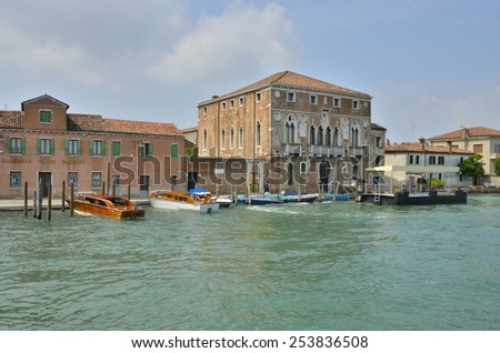 MURANO, ITALY -AUGUST 10: Exterior glass factory in Murano next to an historical palace, on August 10, 2014 in Murano, an island of Venice, Italy - stock photo