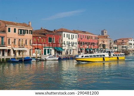 MURANO, ITALY - FEBRUARY 27, 2007: Public transportation boat passes by the Grand canal in Murano, Italy. - stock photo