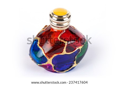 MURANO - ITALY- JULY 3, 2014: Hand Painted Perfume Bottle. Today, the artisans of Murano still employ these centuries-old techniques from contemporary art glass to Murano glass chandeliers. - stock photo