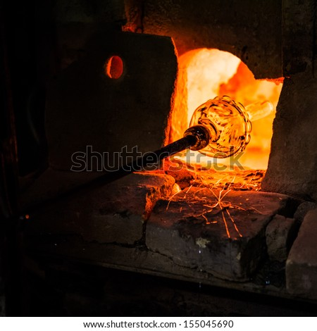 MURANO, ITALY - JULY 26: Manufacturing glass in a traditional oven on July 26, 2013 in Murano Italy. - stock photo