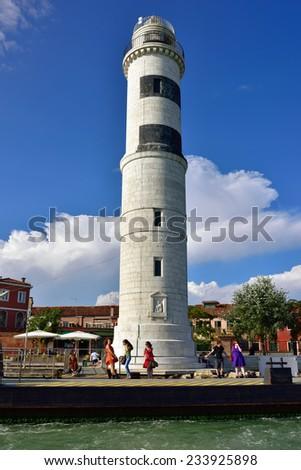 MURANO, ITALY - SEP 22, 2014:  The tower of the lighthouse, Murano faro, Murano island, Venice. Landmark of Veneto region, Italy - stock photo