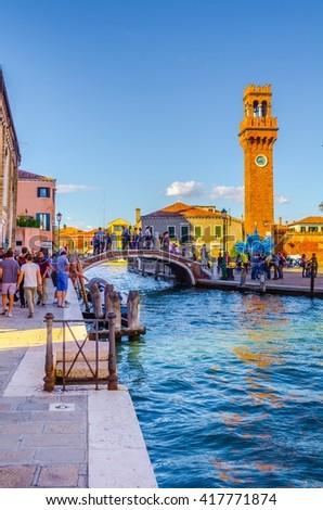 MURANO, ITALY, SEPTEMBER 20, 2015: Glass artwork of blue star and clock tower on Murano island. Venice, Italy  - stock photo