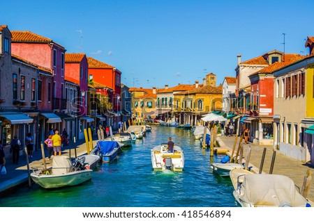 MURANO, ITALY, SEPTEMBER 20, 2015: view of a channel on murano island in italy which is surrounded with tourist shops selling famous murano glass - stock photo