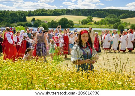 MURANOVO - JULY 20: Russian traditional festival at the end of the haying. On July 20, 2014 in Museum-Reserve Muranovo named after F.Tyutchev. Moscow region, Russia - stock photo