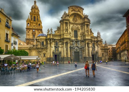 MURCIA, SPAIN - JULY 12: Travel cathedral square in town a rainy day on Murcia July 12, 2013 - stock photo