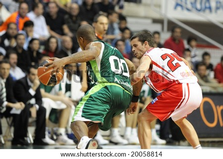 Murcia, Spain - November 2: Omar Cook of Unicaja Malaga and Gonzalo Martinez of CB Murcia during the game at Palacio de los Deportes on November 2, 2008 in Murcia, Spain