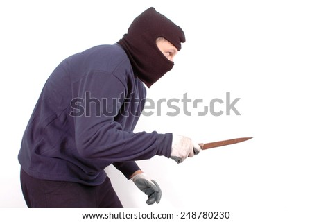Murderer in the balaclava with the knife in the hand - stock photo