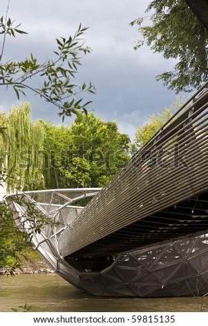 Murinsel is a island in the river Mur. Steel grid structure in the shape of a half-opened shell - stock photo