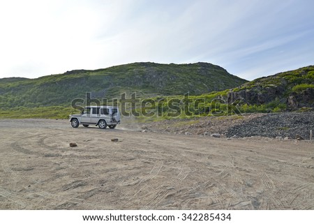 MURMANSK REGION, RUSSIA - JULY 19, 2015: The car goes on a dirt road of the Kola Peninsula