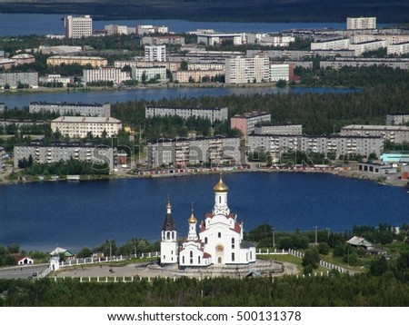 Murmansk region, Russia: Small northern town Monchegorsk, surrounded by lakes - view from mountains to Holy Ascension Cathedral