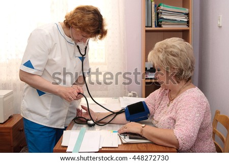 Murmansk, Russia - August 29, 2007, Medical practice and measures the pressure of the woman in the workplace librarian