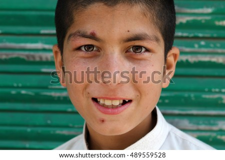 MURREE, PAKISTAN - SEP 13, 2016: Portrait of an unidentified Pakistani boy on the street in famous tourist city of Murree, Pakistan