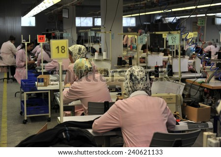 MUS, TURKEY - APRIL 24, 2011: Unidentified  women ironed shirts in clothing factory,l on April 24, 2011 Mus,Turkey