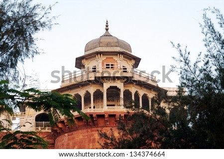 Musamman Burj is an octagonal tower with balcony at the Agra Fort, giving an excellent view of the Taj Mahal. Mughal emperor Shah Jahan spent the last eight years of his life under house arrest here. - stock photo
