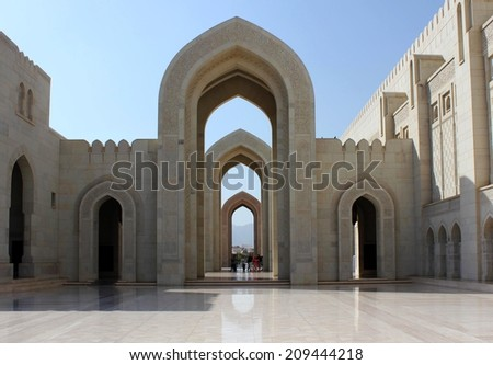 Muscat, Oman, October 19, 2013. The Sultan Qaboos Grand Mosque is the main Mosque in the Sultanate of Oman. View of the external with its beautiful arch architecture, done with Indian sandstone.