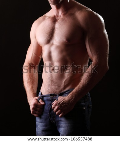 muscle  body on black background - stock photo