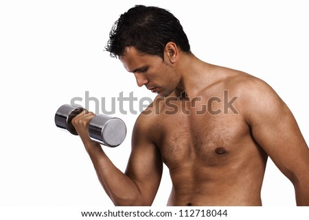 Muscle building young man in workout