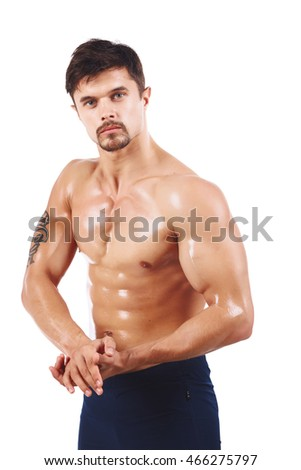 Muscle fury man poses in studio. Isolated over white
