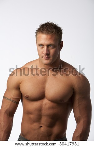 Muscle guy with jeans on white background